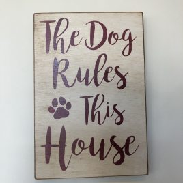 The Dog Rules This House sign